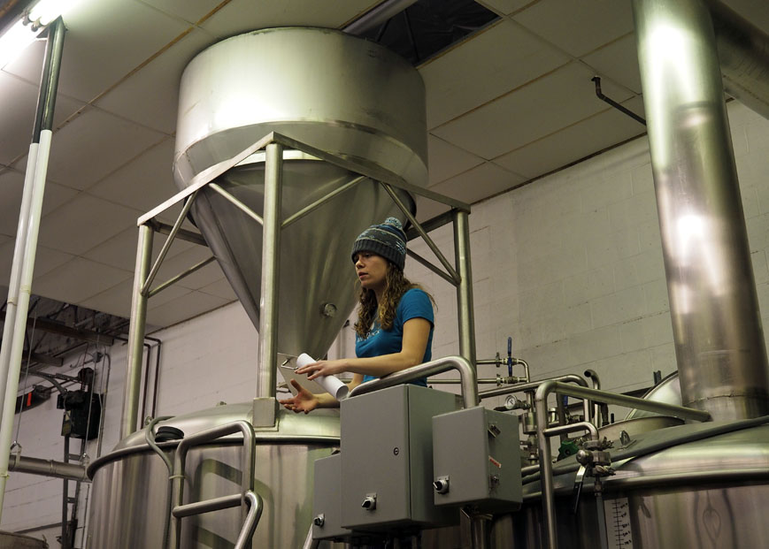 Lauren between the mash tun and boil kettle.