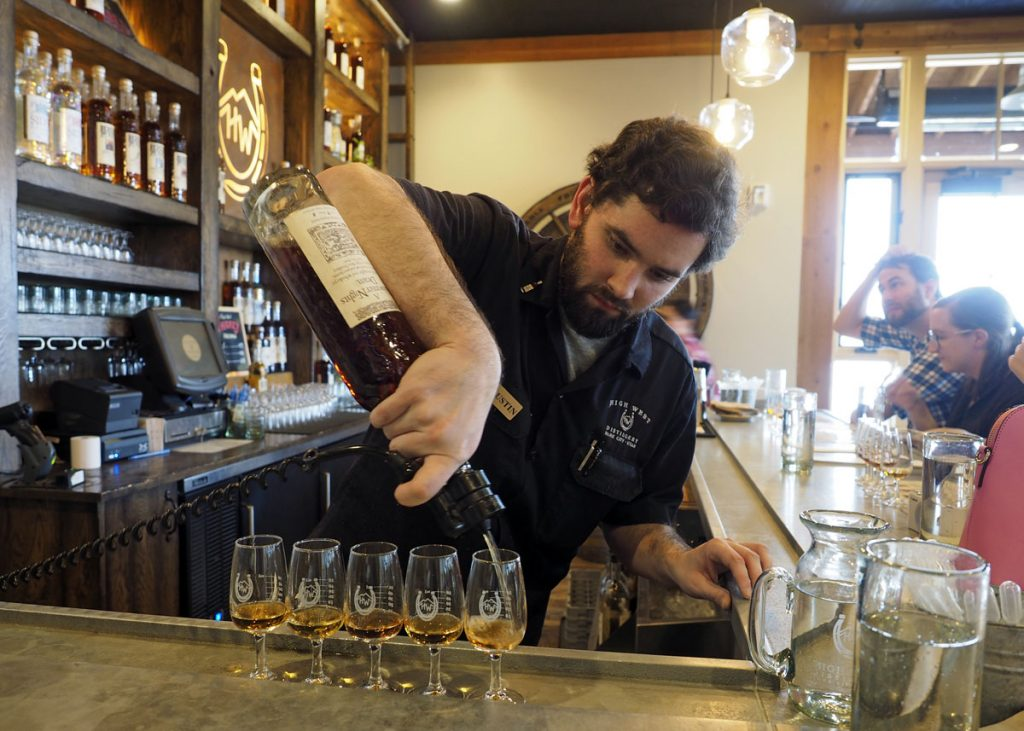 Pouring a Whiskey Flight - Copyright Crafty Beer Girls